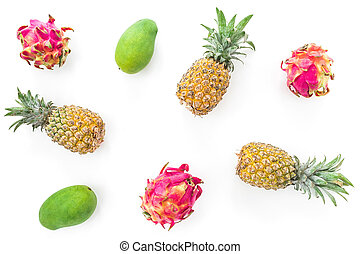 Tropical fruit pattern with pineapple, mango and dragon fruits isolated on white background. Flat lay, top view