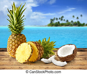 tropical fruit - fresh pineapple and coconut in tropical...