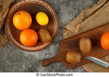 Tropical fruits on a rustic background. Top view.