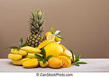 Tropical fruits on the table - Variety of yellow tropical ...