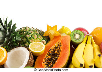 tropical fruits against white background