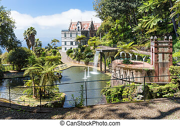 Tropical garden with pond and palace at Funchal,  Madeira island, Portugal