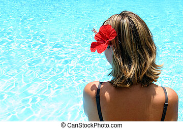 Tropical Girl - Girl by pool with flower in herhair