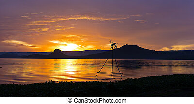 Tropical golden sunset on the lake
