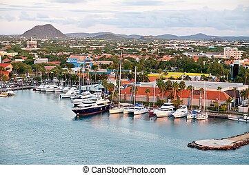 A view of the main harbor on Aruba looking inland. This photo, from a cruise ship, looks down over the city and boats. Dutch province named Oranjestad, Aruba - beautiful Carribean Island.