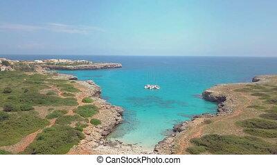Tropical Ionian Greece Blue Lagoon island Aerial 4k travel video. Ocean sea forest coast seashore, water, yacht boat