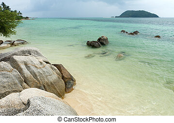 tropical island beach at ko phangan, thailand