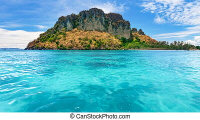 Tropical island coral reef with turquoise water