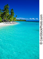 Tropical island in Fiji with sandy beach