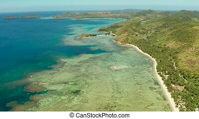 tropical island with blue lagoon - Aerial drone coastline of...