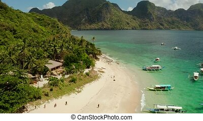 Tropical island with sandy beach. El nido, Philippines -...