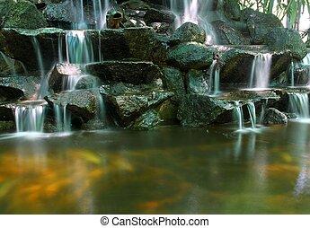 tropical Koi pond with waterfall