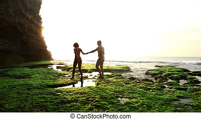 Tropical lagoon - Cheerful couple in love walking on Bali...