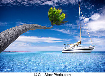 Tropical Lagoon - Sailing Boat in tropical lagoon with...
