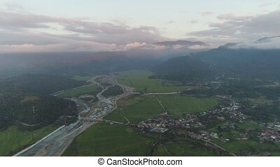 Tropical landscape mountain valley with villages and...