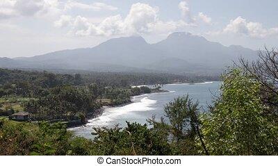 Tropical landscape, mountain view, ocean. Bali island....