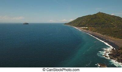 Tropical landscape, sea, beach, mountains.