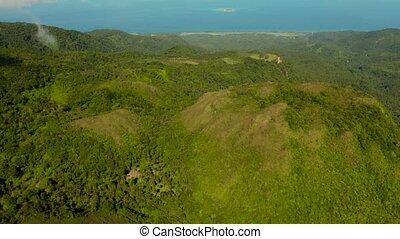 tropical landscape sea coast, mountains - Mountains covered...