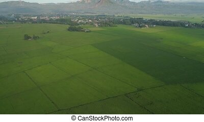 Tropical landscape with farmland, mountains. - Aerial view:...