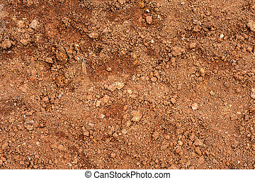 Tropical laterite soil or red earth background. Red mars seamless sand background. Top view