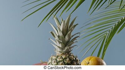 Tropical leaves and ripe pineapple with fresh natural exotic...