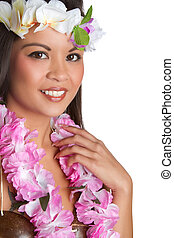 Beautiful exotic woman wearing tropical lei
