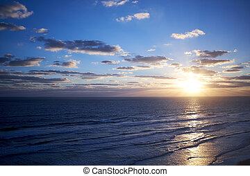 Tropical marine sunset over a calm ocean