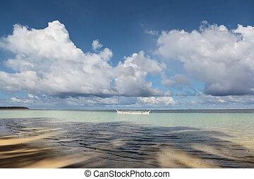 Tropical ocean with fishermen boat