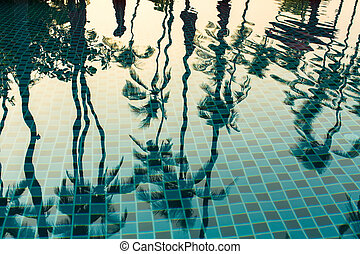 Tropical palm trees reflection
