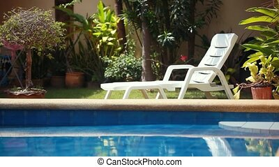 Tropical paradise. Sunbed lounger near the swimming pool. 1920x1080