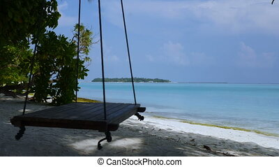 Beautiful beach of Maldives with a swing. - Tropical...