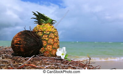 Tropical pineapple cocktail drink at the caribbean beach. -...