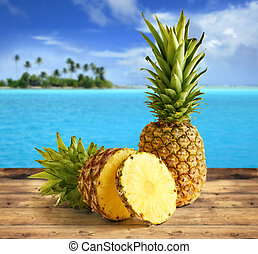 tropical pineapple - pineapple on wooden table in a tropical...
