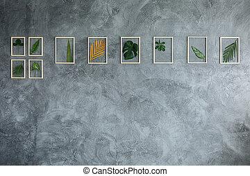 Tropical plants on gray wall