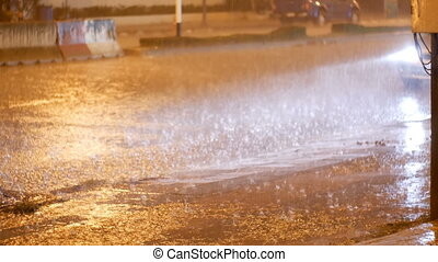 Tropical Rainfall at Night on the Road in Asia. Cars Stand...