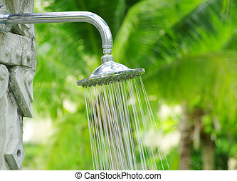 refreshing shower - Tropical refreshing shower under palm...