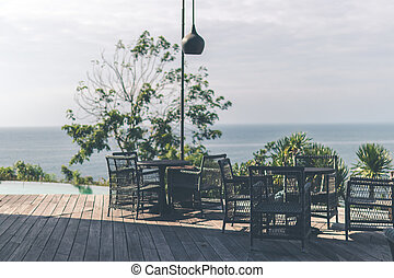 Tropical restaurant with sea view. Sunny day. Space for text. Bali island.