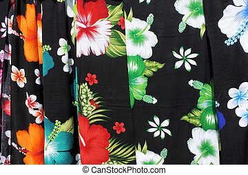 Tropical sarong on display in Rarotonga market Cook Islands. Traditional fabric patterns worn by Polynesians and other South Pacific Islanders and Oceanic people.