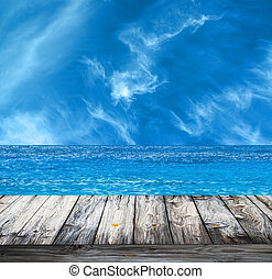 Tropical sea and wooden floor background
