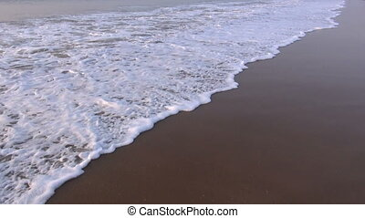 tropical sea waves on beach