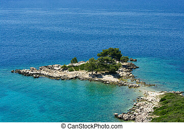 Tropical seashore with headland