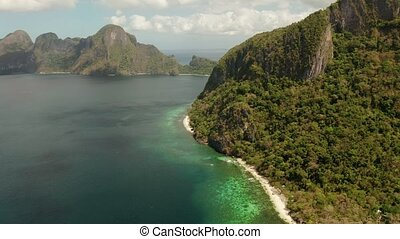 Tropical seawater lagoon and beach, Philippines, El Nido. -...