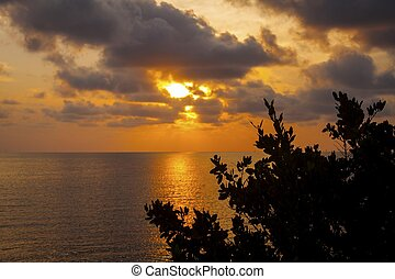 tropical sunset, clouds and the ocean