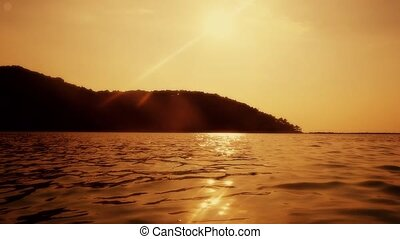 Tropical sunset in the sea, amazing golden colors. slow motion.