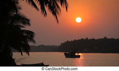 Tropical sunset seascape with a boat