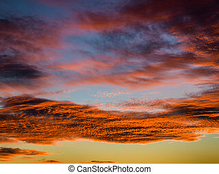 Tropical sunset with beautiful clouds in orange and the twilight sky