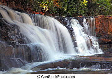 Tropical Tadtone waterfall in rain forest in Chaiyaphum...