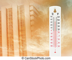 Tropical temperature of 34 degrees Celsius, measured on an outdoor thermometer with tower background
