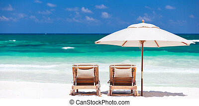 Tropical vacation - Two chairs and umbrella on stunning...