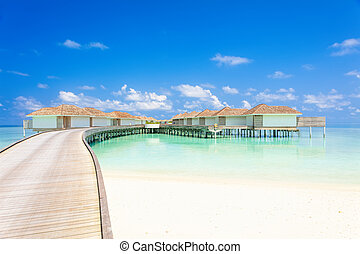 Tropical Water villas on Maldives island in the morning, holiday vacation background concept